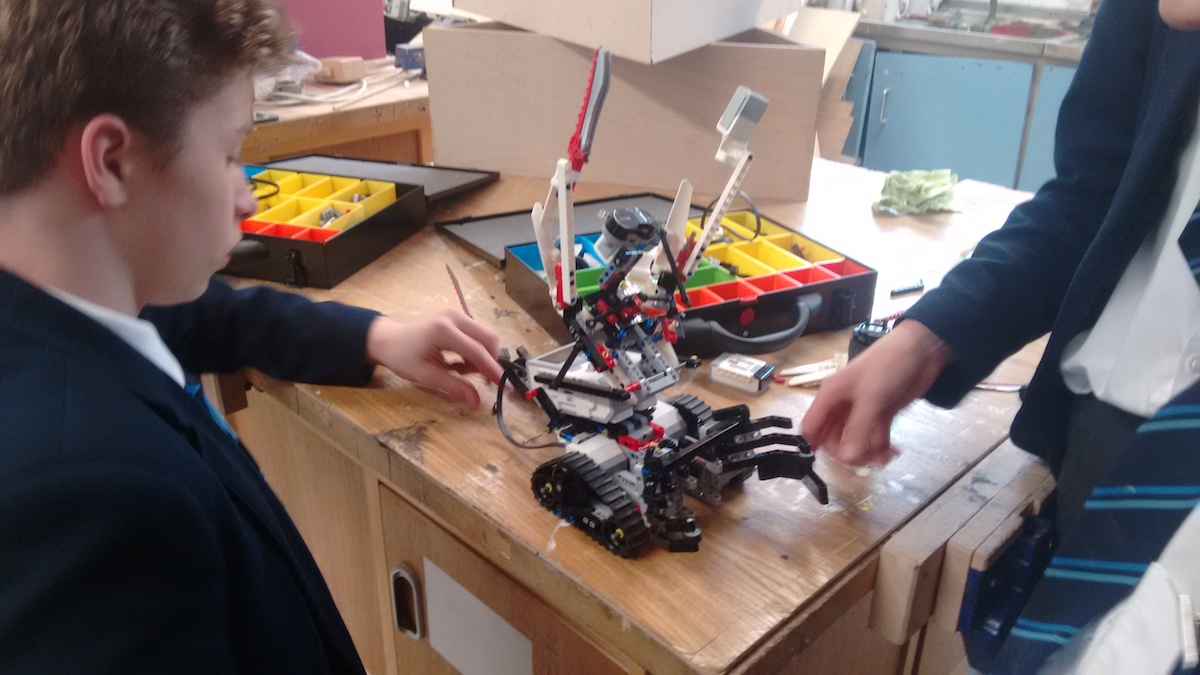 Secondary school student with his Lego Mindstorm robot