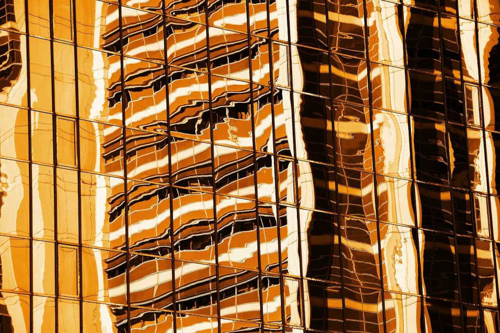 Orange image of reflected office buildings