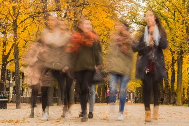 Blurred image of a group of students walking in the Autumn