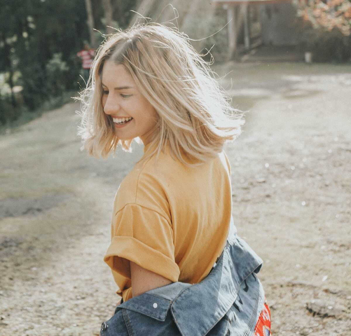 Blonde young woman smiling on a walk