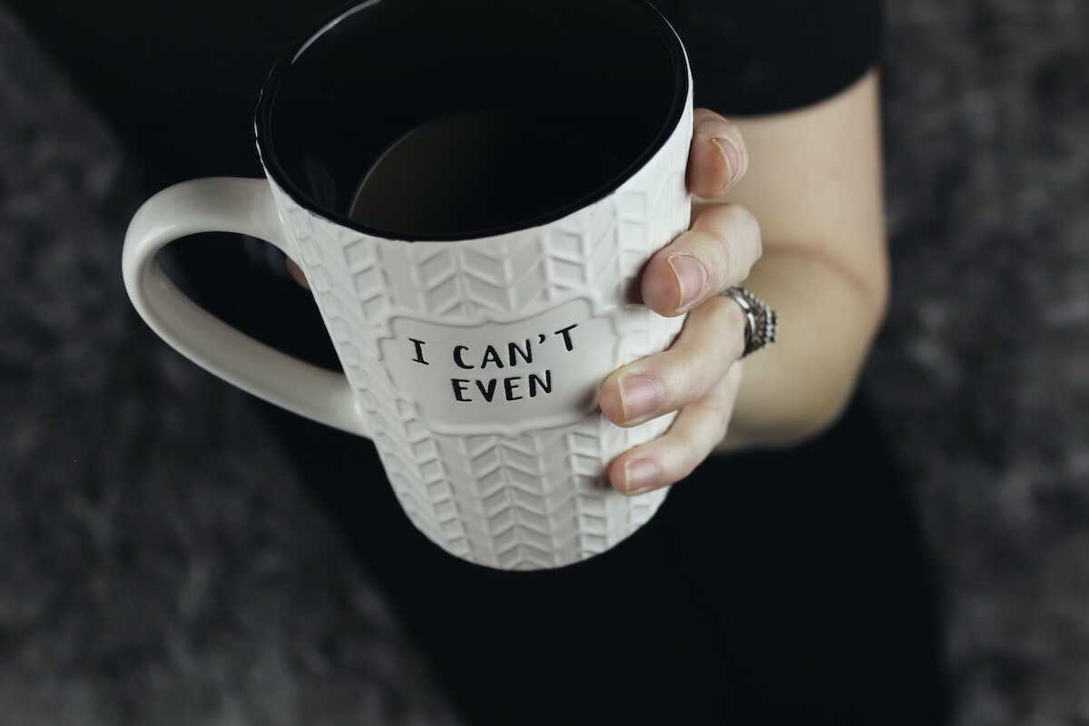 Hands clasping a mug featuring the words I can't even