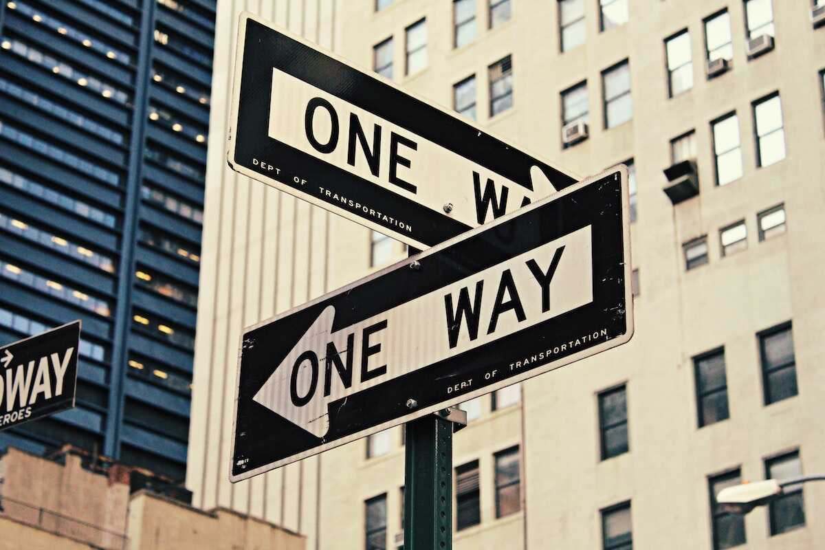 One way street signs in two directions