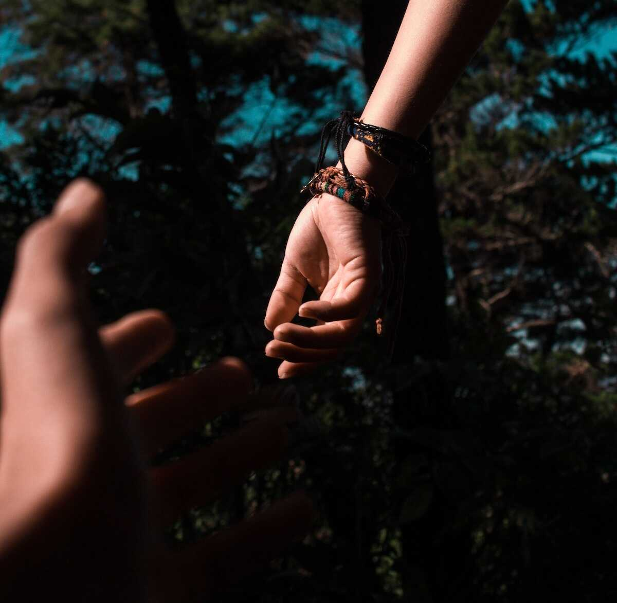 Two hands reaching out to one another