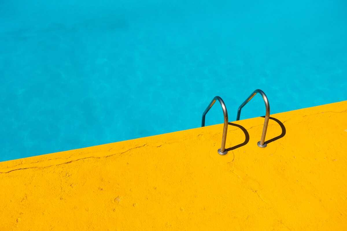 Close up of a swimming pool with a yellow poolside