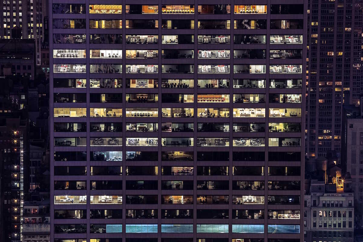 Looking into the windows of an office building at night