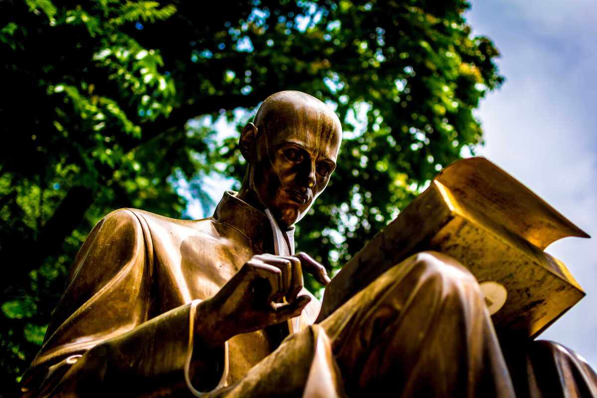 Bronze statue of a man reading