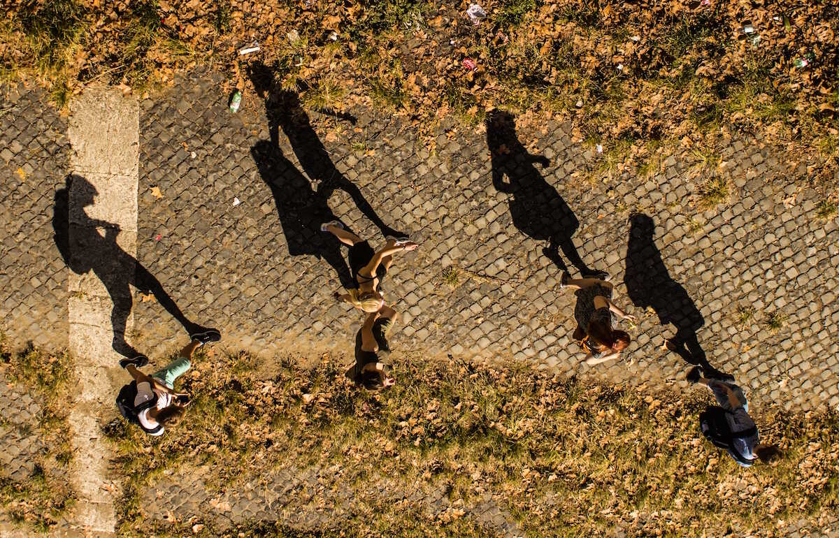 Overhead image of students walking and their shadows